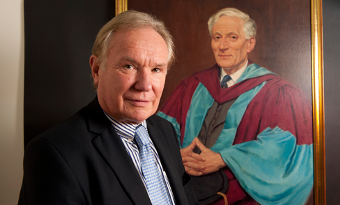 Prof Sir David Payne, Director, with portrait of Prof Eric Zepler